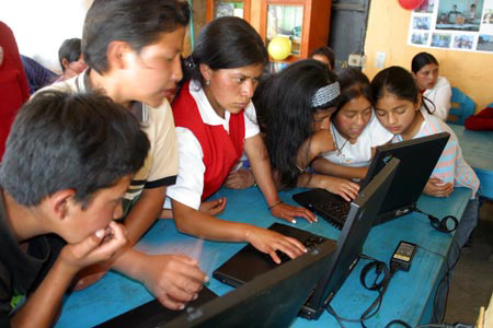Students using donated laptops.