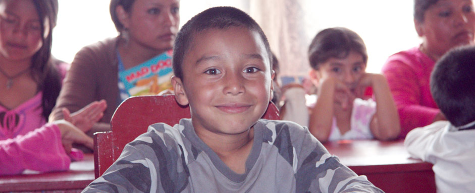 boy sitting at table in La Pedrera classroom