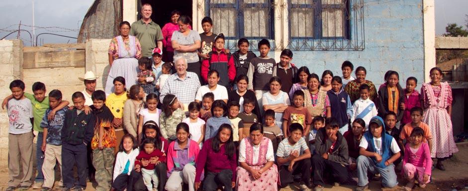 students, teachers, and visitors in front of La Pedrera School