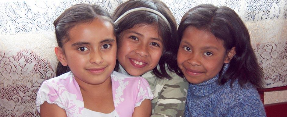 three girls in La Pedrera classroom
