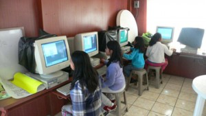 La Pedrera students using computers supplied by LPSP.